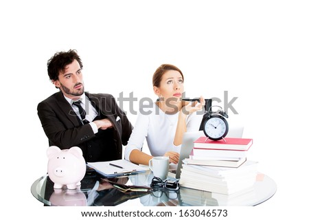 Closeup portrait of young couple, man pulling out money from black suit pocket to give to demanding unhappy woman who looks away frustrated isolated on white background.Financial relationship conflict - stock photo