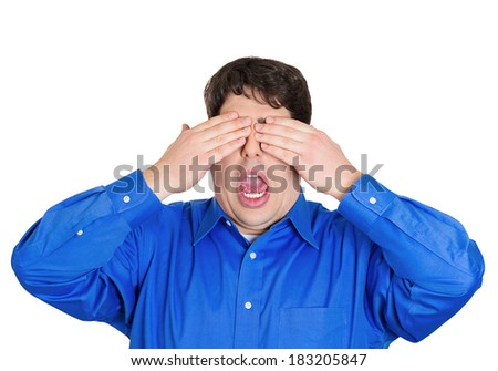 Closeup portrait of young, coy man closing eyes with hands can't see and hiding, mouth wide open, isolated white background. See no evil concept. Negative emotion facial expression feelings - stock photo