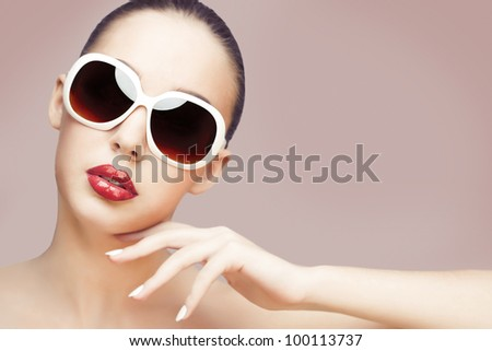 closeup portrait of young gorgeous caucasian woman wearing sunglasses - stock photo