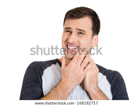 Closeup portrait of young guy with very bad tooth ache isolated on white background. Human face expressions, feelings, perception, reaction. Oral, dental hygiene and care.  - stock photo