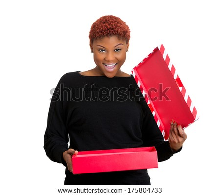 Closeup portrait of young happy excited woman opening red gift box, very pleased and grateful with what she received, isolated on white background. Positive emotion facial expression feeling attitude - stock photo