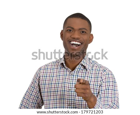 Closeup portrait of young laughing handsome excited, happy man pointing at you camera gesture with finger, isolated on white background. Positive emotion facial expression feelings, body language - stock photo
