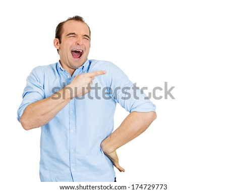 Closeup portrait of young man, laughing, pointing with finger, arms at someone, something, isolated on white background. Positive human face expression, emotion, feelings, attitude, approach, reaction - stock photo