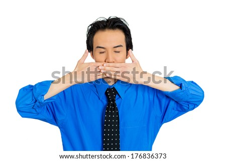 Closeup portrait of young man, student, worker, boy, employee, covering his mouth. Speak no evil concept, isolated on white background. Human emotions, face expressions, feelings, signs, body language - stock photo