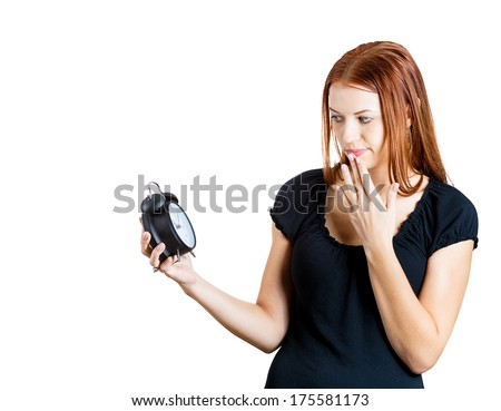 Closeup portrait of young pretty beautiful woman frustrated by lack of time to perform all duties for the day, isolated on white background. Negative emotion facial expression feelings, body language - stock photo