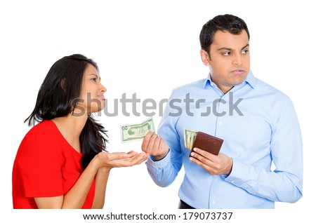 Closeup portrait of young pretty woman begging for money, but upset man is reluctant to give cash dollar bills out, isolated on white background. Negative emotion facial expression feelings. - stock photo