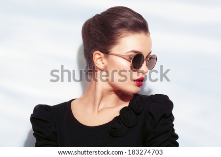 Closeup portrait of young pretty woman in summer sunny day  - stock photo