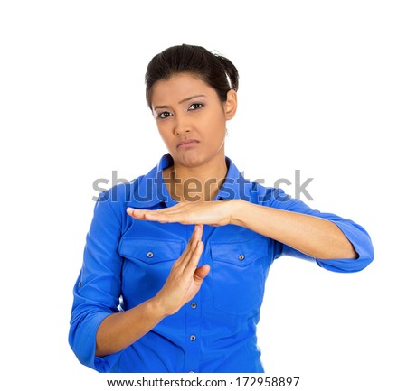 Closeup portrait of young serious woman showing a time out gesture with hands isolated on white background. Negative emotion facial expression feelings, body language - stock photo
