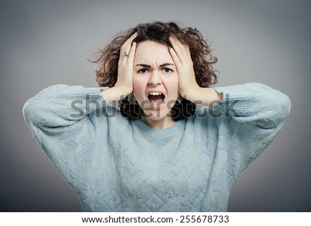 Closeup portrait of young, upset, sad depressed, worried, troubled brunette woman holding her head with both hands, isolated. Human emotions, face expressions, feelings, perception - stock photo