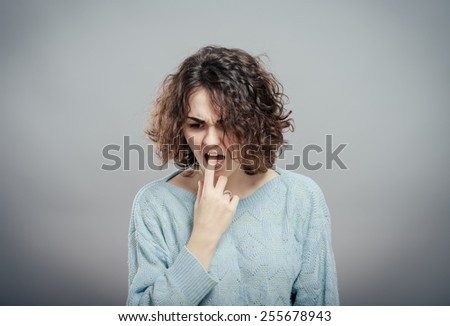 Closeup portrait of young woman, annoyed, frustrated  fed up sticking fingers in her throat showing she is about to throw up. Case anorexia nervosa, Isolated - stock photo