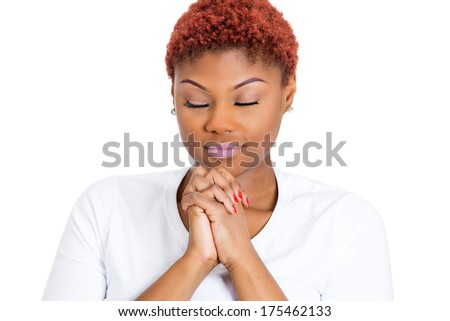 Closeup portrait of young woman praying eyes closed looking down hoping for the best asking for forgiveness or miracle isolated on white background. Positive human emotions, facial expression feelings - stock photo