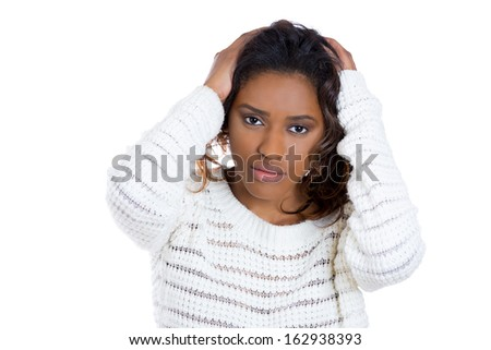 Closeup portrait of young woman with bad headache hands on head looking at camera gesture, isolated on white background copy space to left. Negative human facial expression  - stock photo