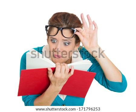 Closeup portrait of young woman, with wide opened eyes staring at book page, shocked, surprised by the twists, turn of story, isolated on white background. Human emotions, facial expression, feeling - stock photo