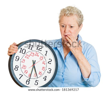 Closeup portrait old business woman, funny looking elderly lady holding clock, stressed running out, pressured by lack of time, aging, late for meeting isolated on white background. Negative emotions - stock photo