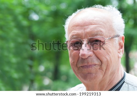 Closeup portrait on a smiling old man  - stock photo