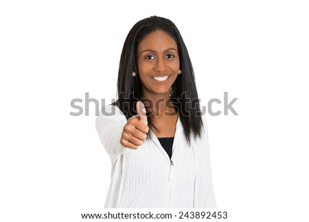 Closeup portrait pretty friendly pleased middle aged smiling woman giving thumbs up at camera sign isolated white background. Positive human emotions facial expression feeling symbols body language  - stock photo