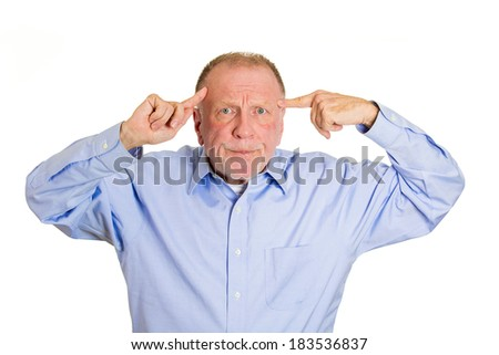 Closeup portrait, rude, angry,senior mature business man gesturing with finger against temple, are you crazy? Isolated white background. Negative human emotions, facial expression, feeling, attitude - stock photo