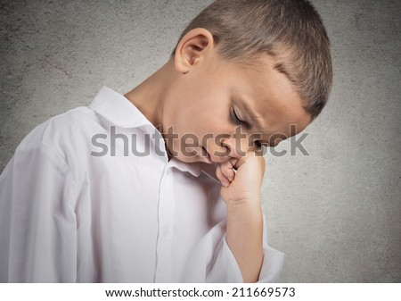 Closeup portrait sad, depressed, alone, tired disappointed child resting his face on hand, isolated grey wall background. Negative human emotion, face expression feeling, life perception body language - stock photo