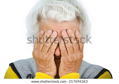 Closeup portrait sad depressed, stressed, thoughtful, senior, old woman, gloomy, worried, covering her face, isolated on white background. Human face expressions, emotion, feelings, reaction, attitude - stock photo