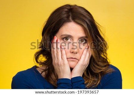 Closeup portrait sad, depressed, stressed, thoughtful young woman, full of worries, looking confused, lost isolated yellow background. Human face expressions, emotions, feelings, reaction, attitude - stock photo