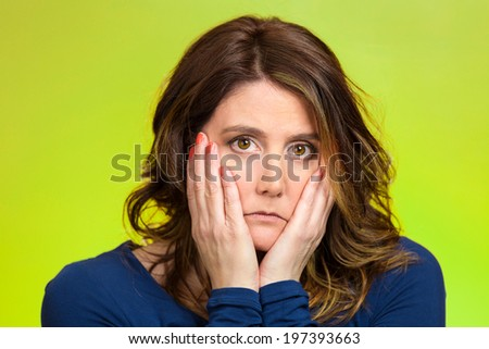 Closeup portrait sad, depressed, stressed, thoughtful young woman, full of worries, looking confused, lost isolated green background. Human face expressions, emotions, feelings, reaction, attitude - stock photo