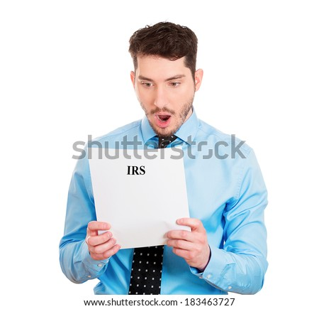 Closeup portrait, sad, shocked funny looking young man disgusted at his IRS statement, isolated white background. Negative human emotion facial expression feelings. Financial crisis, bad news - stock photo