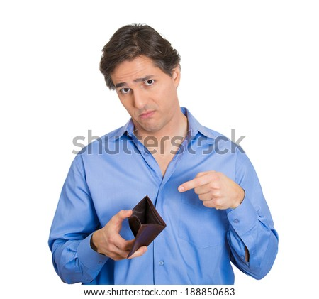 Closeup portrait, sad, upset, unemployed broke guy, fired employee, jobless business man, holding, showing his empty wallet, isolated white background. Bankruptcy, financial problems, mistakes - stock photo
