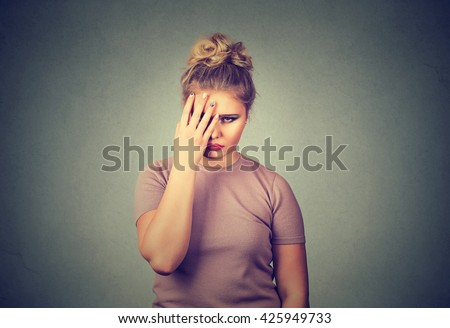 Closeup portrait sad young beautiful woman with worried stressed face expression looking down - stock photo