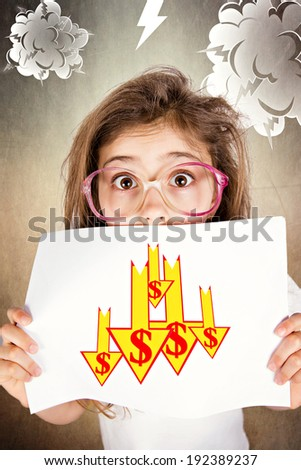 Closeup portrait scared, funny looking little girl with glasses, holding market, dollar going down, isolated dark, grey background with clouds. Facial expressions, emotions. Future economy worries  - stock photo