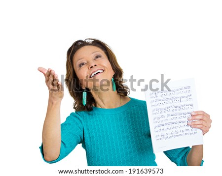 Closeup portrait senior, elderly, happy, joyful woman holding music sheet notes, listening to  classic melody, isolated white background. Positive human emotions, facial expressions, attitude, life  - stock photo
