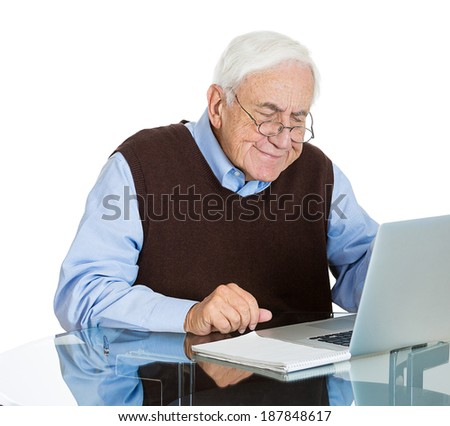 Closeup portrait senior, elderly, mature, man with glasses trying to figure out how use laptop internet isolated white background. Human emotion, facial expression. Age related changes. Old generation - stock photo