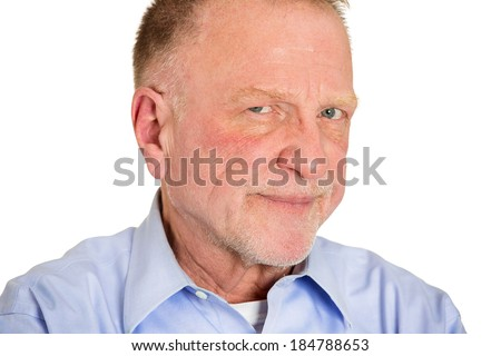 Closeup portrait, senior mature business man,  funny, suspicious annoyed looking being cautious, careful, attentive, thinking, of his own mind, isolated white background. Emotion, facial expression - stock photo