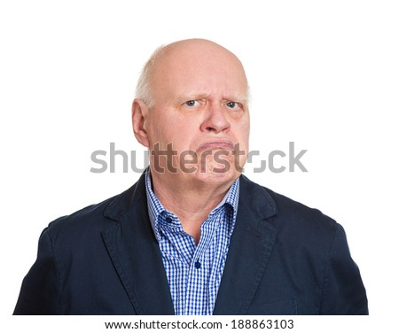 Closeup portrait, senior mature business man, funny, suspicious, annoyed looking being cautious, careful, attentive, thinking, of his own mind, isolated white background. Emotion, facial expression - stock photo
