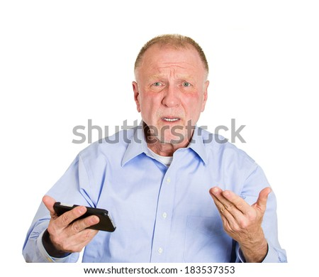 Closeup portrait, senior mature business man, upset, sad, by what he sees on his cell phone, an sms, text message or email, isolated white background. Negative emotion facial expression feelings. - stock photo