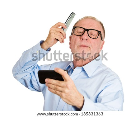 Closeup portrait, senior mature, haughty, arrogant man admiring himself in the mirror combing his hair, smiling, isolated white background. Human emotions, facial expressions, feelings, attitude - stock photo
