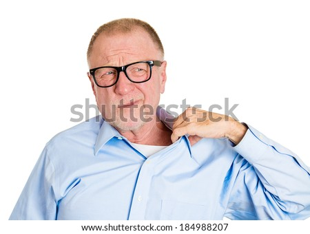 Closeup portrait senior mature man in black glasses opening shirt to vent, it's hot, unpleasant, awkward situation, embarrassment. Isolated white background. Negative human emotions, facial expression - stock photo