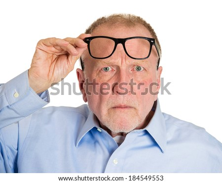 Closeup portrait, senior mature man, lifting black glasses up, surprised and angry by what he sees or heard, isolated white background. Negative human emotion facial expression feelings, reaction - stock photo