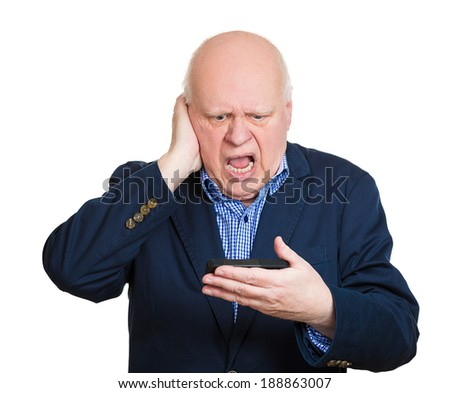 Closeup portrait, senior mature, pissed off, open mouth, by what he sees on his cell phone, an sms, text message or email, isolated white background. Negative emotion facial expression feelings. - stock photo