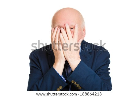 Closeup portrait, senior mature, scared, terrified, horrified, man peeking through covered hand, cant believe what he sees, isolated white background. Negative emotion facial expression feelings. - stock photo