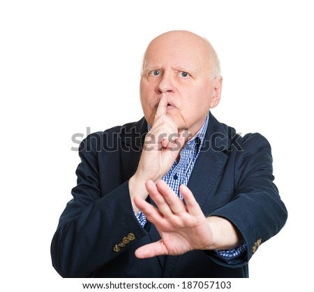 Closeup portrait, senior, serious, mature man placing finger on lips with shhh sign symbol, isolated white background. Negative emotions, facial expressions, feelings, body language, attitude, control - stock photo