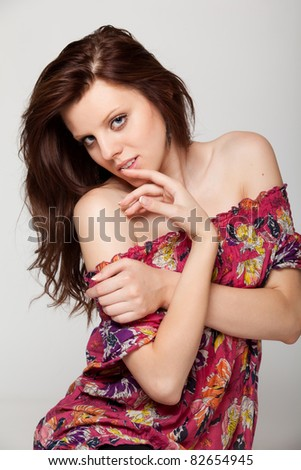 closeup portrait sexy young woman with finger to lips isolated on white background - stock photo