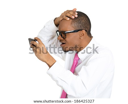 Closeup portrait, shocked nerd man feeling head, surprised he is losing hair, receding hairline or seeing bad news on cellphone, isolated white background. Negative facial expressions, emotion feeling - stock photo