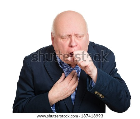Closeup portrait, sick old man, senior worker, elderly executive guy, having severe infectious cough, holding chest, raising fist to mouth looking miserable unwell, isolated white background.  - stock photo