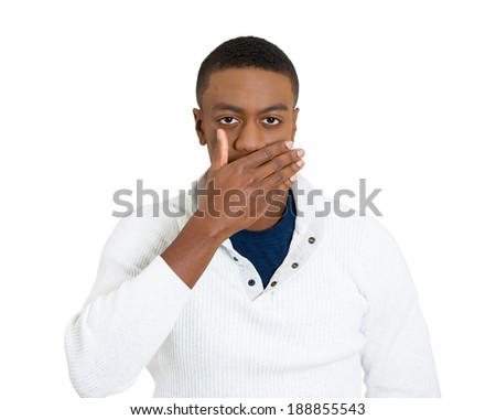 Closeup portrait, silent young man covering closed mouth observing. Speak no evil concept, isolated white background. Negative human emotions, facial expressions signs, symbols. Media news coverup - stock photo