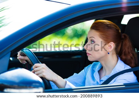 Closeup portrait sleepy, tired, fatigued, exhausted young woman falling asleep, trying to stay alert while driving her car after long hour trip, isolated street background. Transportation, sleep - stock photo