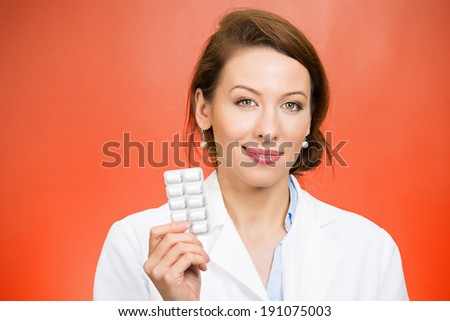 Closeup portrait smiling, health care professional, family doctor, endocrinologist, gynecologist, nutritionist, dentist holding, offering chewing gum, pills, vitamins. Female birth control methods - stock photo