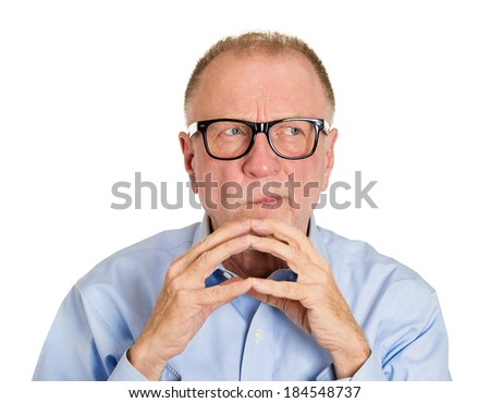 Closeup portrait, sneaky, sly, senior mature man in black glasses trying to plot something, screw someone, isolated on white background. Negative human emotions, facial expressions, feelings, attitude - stock photo