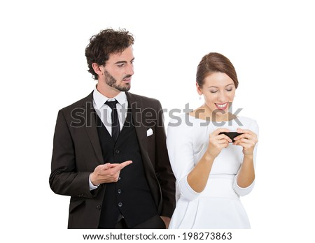 Closeup portrait sneaky upset jealous possessive boyfriend angry watching girlfriend happily texting someone else isolated white background. Negative emotion facial expression feeling conflict concept - stock photo