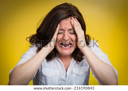 Closeup portrait stressed business woman having breakdown hysterical yelling screaming with temper tantrum isolated yellow background. Negative human emotions facial expressions reaction attitude - stock photo