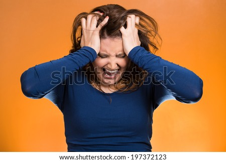 Closeup portrait  stressed business woman, pulling her hair out, yelling, screaming with temper tantrum isolated orange background. Negative human emotions, facial expressions, reaction attitude - stock photo